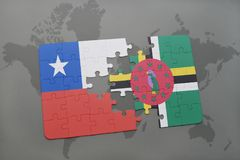 Puzzle with the national flag of chile and dominica on a world map background. Royalty Free Stock Images