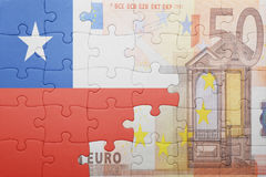 Puzzle with the national flag of chile and euro banknote. Concept Stock Image