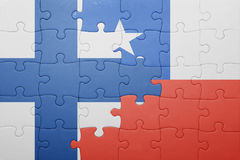 Puzzle with the national flag of chile and finland Royalty Free Stock Images