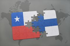 Puzzle with the national flag of chile and finland on a world map background. Stock Image