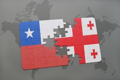 Puzzle with the national flag of chile and georgia on a world map background. Stock Images