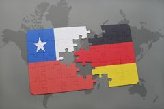 Puzzle with the national flag of chile and germany on a world map background. 3D illustration stock photo