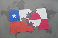 Puzzle with the national flag of chile and greenland on a world map background. Royalty Free Stock Photos