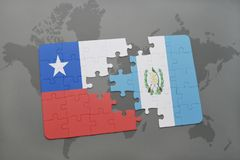 puzzle with the national flag of chile and guatemala on a world map background. Royalty Free Stock Photography