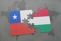 Puzzle with the national flag of chile and hungary on a world map background. Stock Photos