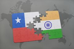 Puzzle with the national flag of chile and india on a world map background. Royalty Free Stock Images