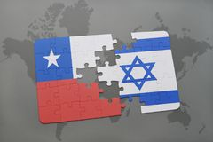 Puzzle with the national flag of chile and israel on a world map background. Stock Image