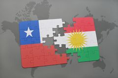 Puzzle with the national flag of chile and kurdistan on a world map background. Stock Image
