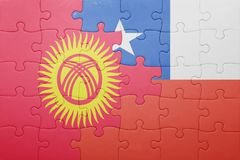 Puzzle with the national flag of chile and kyrgyzstan Royalty Free Stock Photo