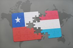 Puzzle with the national flag of chile and luxembourg on a world map background. Royalty Free Stock Image