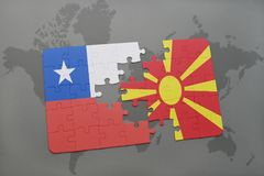 Puzzle with the national flag of chile and macedonia on a world map background. Stock Photo