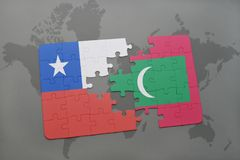 puzzle with the national flag of chile and maldives on a world map background. Royalty Free Stock Photo