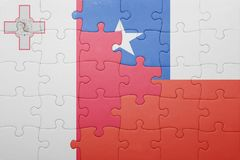 Puzzle with the national flag of chile and malta. Concept Stock Photos