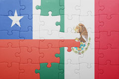 Puzzle with the national flag of chile and mexico. Concept stock photo