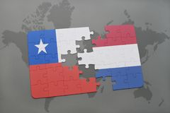 Puzzle with the national flag of chile and netherlands on a world map background. Royalty Free Stock Image