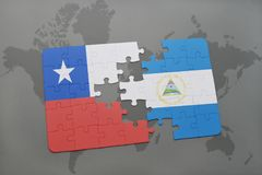 Puzzle with the national flag of chile and nicaragua on a world map background. Stock Photos