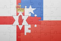 Puzzle with the national flag of chile and northern ireland Royalty Free Stock Images