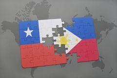 Puzzle with the national flag of chile and philippines on a world map background. Royalty Free Stock Image