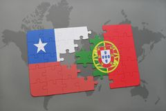 Puzzle with the national flag of chile and portugal on a world map background. Stock Photo