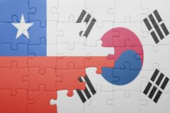 Puzzle with the national flag of chile and south korea. Concept royalty free stock photo