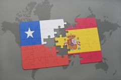 Puzzle with the national flag of chile and spain on a world map background. Stock Photography
