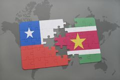 Puzzle with the national flag of chile and suriname on a world map background. Royalty Free Stock Photography