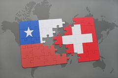Puzzle with the national flag of chile and switzerland on a world map background. Royalty Free Stock Images