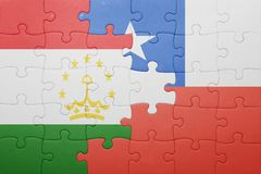 Puzzle with the national flag of chile and tajikistan Royalty Free Stock Image