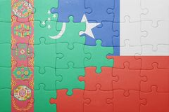 Puzzle with the national flag of chile and turkmenistan Royalty Free Stock Photos