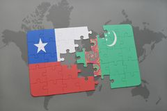 Puzzle with the national flag of chile and turkmenistan on a world map background. Stock Image