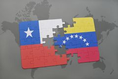 Puzzle with the national flag of chile and venezuela on a world map background. Royalty Free Stock Photography