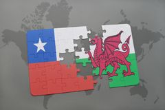 Puzzle with the national flag of chile and wales on a world map background. Stock Photos