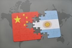 Puzzle with the national flag of china and argentina on a world map background. Royalty Free Stock Images