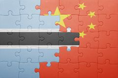 Puzzle with the national flag of china and botswana Royalty Free Stock Photos