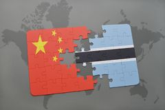 Puzzle with the national flag of china and botswana on a world map background. 3D illustration Royalty Free Stock Photo