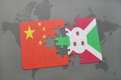 Puzzle with the national flag of china and burundi on a world map background. 3D illustration Royalty Free Stock Photography