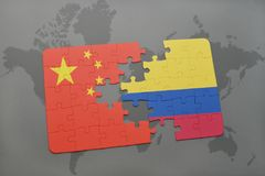 Puzzle with the national flag of china and colombia on a world map background. 3D illustration royalty free stock photos