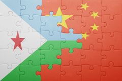 Puzzle with the national flag of china and djibouti Stock Images