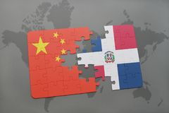 puzzle with the national flag of china and dominican republic on a world map background. Royalty Free Stock Photo