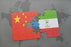 Puzzle with the national flag of china and equatorial guinea on a world map background. 3D illustration Stock Photo