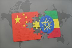 Puzzle with the national flag of china and ethiopia on a world map background. 3D illustration Royalty Free Stock Photography