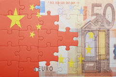 Puzzle with the national flag of china and euro banknote Royalty Free Stock Photo