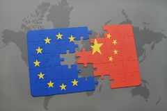 Puzzle with the national flag of china and european union on a world map background. Concept Royalty Free Stock Photos