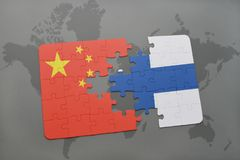 Puzzle with the national flag of china and finland on a world map background. 3D illustration Stock Photo