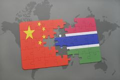 Puzzle with the national flag of china and gambia on a world map background. 3D illustration Stock Photos