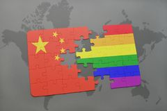 Puzzle with the national flag of china and gay rainbow flag on a world map background. 3D illustration Royalty Free Stock Images