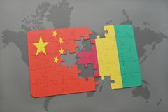 Puzzle with the national flag of china and guinea on a world map background. 3D illustration Stock Images