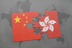 Puzzle with the national flag of china and hong kong on a world map background. 3D illustration stock photo