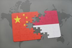 Puzzle with the national flag of china and indonesia on a world map background. 3D illustration Stock Photos