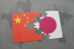 Puzzle with the national flag of china and japan on a world map background. 3D illustration royalty free stock photos